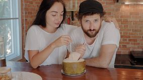 Close up of young couple enjoying their time drinking a fresh coconut. On the kitchen stock video