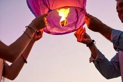 Couple holding luminous Chinese lantern royalty free stock image