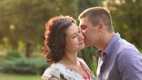 Close-up of a young couple is kissing at sunset. stock video footage