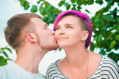 Close up of a young couple kissing Royalty Free Stock Image