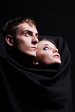 Close-up of a young couple in love. In dar Stock Photography