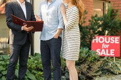 Couple negotiating with house seller stock photos