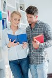 Close up Young Couple Reading Book. At Small Library Royalty Free Stock Photography