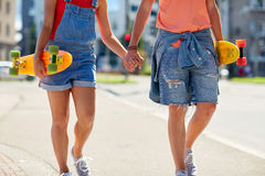 Close up of young couple with skateboards in city Royalty Free Stock Image