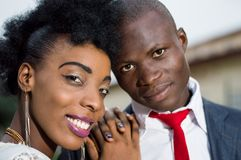 Close-up of young couple smiling at the camera. Royalty Free Stock Photos