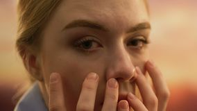Close-up of young crying woman face, suffering from life problems, depression. Stock footage stock video