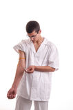 Close up of young doctor injecting medicine in his arm Royalty Free Stock Images