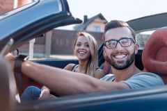Close up.young family travelling in convertible stock images