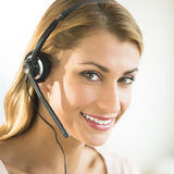 Close-Up Of Young Female Customer Service Representative Stock Photography