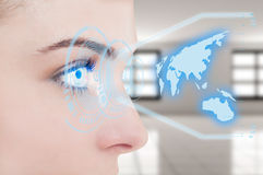 Close-up of young female eye with digital hologram Stock Photo