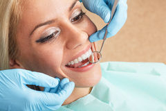 Close-up of young female having teeth examination Stock Photo