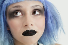 Close-up of young female punk with black lipstick, eye make-up and blue hair Royalty Free Stock Photos
