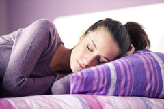 Close-up of  young female sleeping in bed at home Stock Photography
