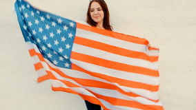 Close Up of Young Ginger Woman Holding Up American Flag stock video footage