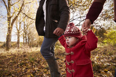 Close Up Of Young Girl On Autumn Walk With Parents Royalty Free Stock Photography