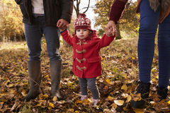 Close Up Of Young Girl On Autumn Walk With Parents Stock Images