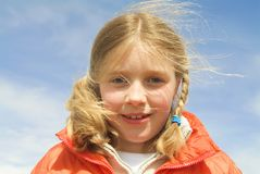 Close-up of a young girl at the beach. (blue sky Stock Image