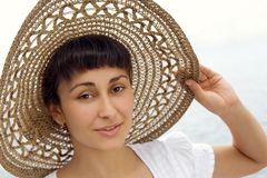 Close-up of the young girl in the bonnet Royalty Free Stock Photography