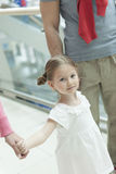 Close-up of young girl holding parents hands Stock Photography