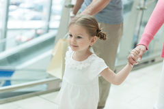 Close-up of young girl holding parents hands Royalty Free Stock Photos