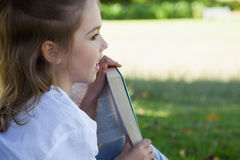 Close-up of young girl reading book in park Stock Images