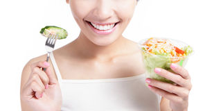 Close up of Young Girl Smile eating salad Royalty Free Stock Photos