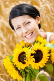 Close up of young girl with sunflowers Stock Photography