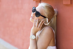 Close up of young girl talking in the phone Royalty Free Stock Photography