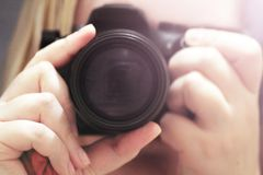 Close up of young girl with vintage camera royalty free stock photo