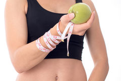 Close-up of a young girl who is holding an apple in his hand Royalty Free Stock Photo