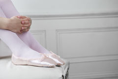 Close up of a young girls feet wearing ballet shoes Royalty Free Stock Images