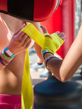 Close up of Young Girls Taping Her Hands in Pink Boxing Tape Stock Photos