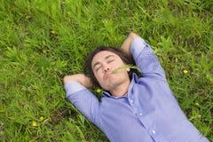 Business man lying on grass Stock Photos