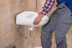 Handyman Installing Sink In Bathroom royalty free stock images