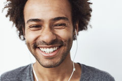 Close up of young happy african man smiling laughing over white background. Stock Photo
