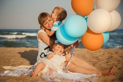 Close up of young happy loving family with small kids, having fun at beach together near the ocean, happy lifestyle family concept stock image