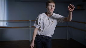Close up of young hip-hop dancer in black trousers and white shirt performing toprock and other elements of breakdance stock video footage