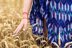 Close up of young hippie woman on cereal field. Nature, youth culture and people concept - close up of young hippie woman on summer cereal field Royalty Free Stock Photos