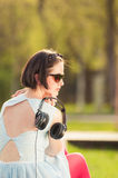 Close-up of young hipster woman with headset in the park Royalty Free Stock Photos