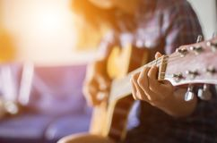 Close up of young hipster woman practiced guitar in the park,happy and enjoy playing guitar royalty free stock photo