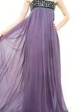 Close up of young lady in long purple dress royalty free stock photography