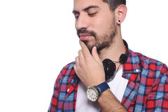Close up of young latin man serious with black headphones. Royalty Free Stock Image