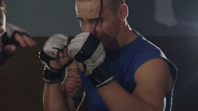 Close-up young male athletes training in boxing gym. Slowly.  stock video footage