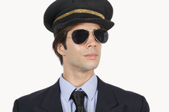 Close-up of young male pilot in uniform against white background Stock Image