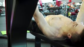 Young Male Powerlifter Train Shoulders And Chest Muscles Doing Bench Press. Close-up - Young Male Powerlifter Train Shoulders And Chest Muscles Doing Bench Press stock video
