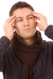 Close-up of a young man. That has an intense headache, isolated on white Stock Image