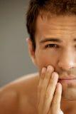 Close-up of young man applying shaving cream Royalty Free Stock Photos