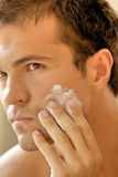 Close-up of young man applying shaving cream Stock Photos