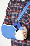 Close Up Of Young Man With Arm In Sling. Man With Arm In Sling Royalty Free Stock Photography
