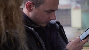 Close up of young man browsing social media on mobile phone during commute.  stock video